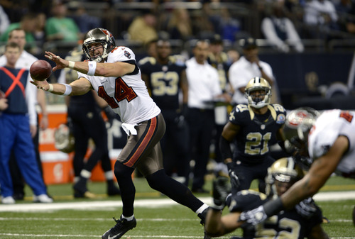 Tampa Bay Buccaneers tight end Dallas Clark (44) pulls in a pass in the second half of an NFL football game against the New Orleans Saints  at the Mercedes-Benz Superdome in New Orleans, Sunday, Dec. 16, 2012. (AP Photo/Bill Feig)