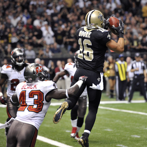 New Orleans Saints wide receiver Lance Moore (16) pulls in a touchdown pass as Tampa Bay Buccaneers free safety Ahmad Black (43) covers in the first half of an NFL football game at the Mercedes-Benz Superdome in New Orleans, Sunday, Dec. 16, 2012. (AP Photo/Bill Feig)