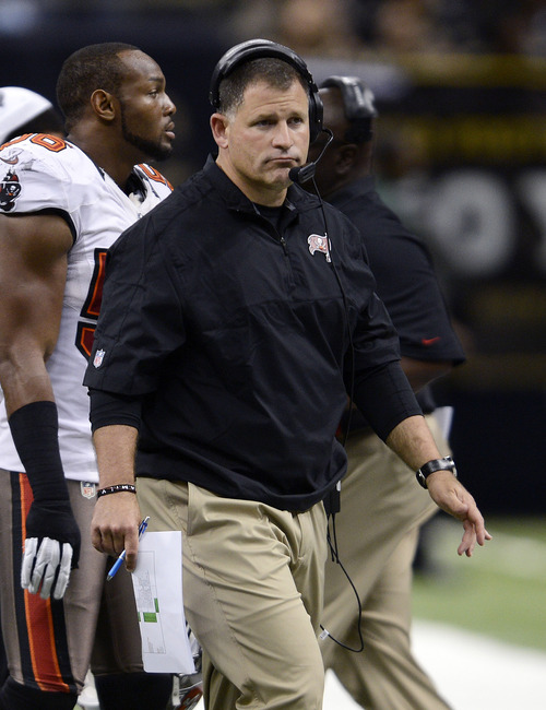 Tampa Bay Buccaneers head coach Greg Schiano walks the sidelines in the second half of an NFL football game against the New Orleans Saints at the Mercedes-Benz Superdome in New Orleans, Sunday, Dec. 16, 2012. (AP Photo/Bill Feig)