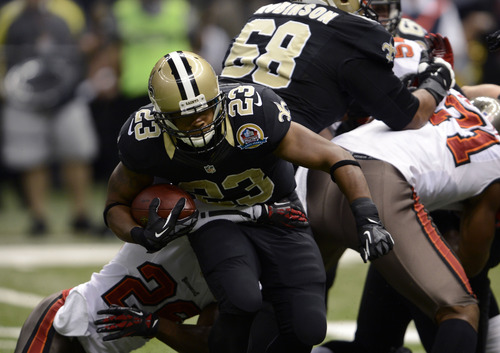 New Orleans Saints running back Pierre Thomas (23) carries in the first half of an NFL football game against the Tampa Bay Buccaneers at the Mercedes-Benz Superdome in New Orleans, Sunday, Dec. 16, 2012. (AP Photo/Bill Feig)