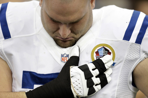 Indianapolis Colts guard Mike McGlynn bows his head during a moment of silence for the victims of the Sandy Hook Elementary School shootings before an NFL football game against the Houston Texans Sunday, Dec. 16, 2012, in Houston. (AP Photo/Eric Gay)