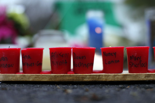 Candles with the names of shooting victims written on them sit at a memorial near Sandy Hook Elementary School, Sunday, Dec. 16, 2012 in Newtown, Conn.  A gunman walked into Sandy Hook Elementary School in Newtown Friday and opened fire, killing 26 people, including 20 children. (AP Photo/Jason DeCrow)