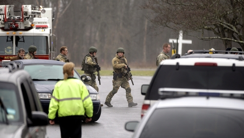 A swat team responds to a bomb threat at St. Rose of Lima Roman Catholic Church, Sunday, Dec. 16, 2012, in Newtown, Conn. Worshippers hurriedly left the church Sunday, not far from where a gunman opened fire Friday inside the Sandy Hook Elementary School in Newtown. (AP Photo/David Goldman)