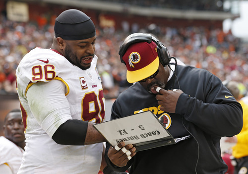 Washington Redskins nose tackle Barry Cofield (96) talks with defensive line coach Jacob Burney on the sidelines in the second quarter of an NFL football game against the Cleveland Browns in Cleveland, Sunday, Dec. 16, 2012. (AP Photo/Rick Osentoski)