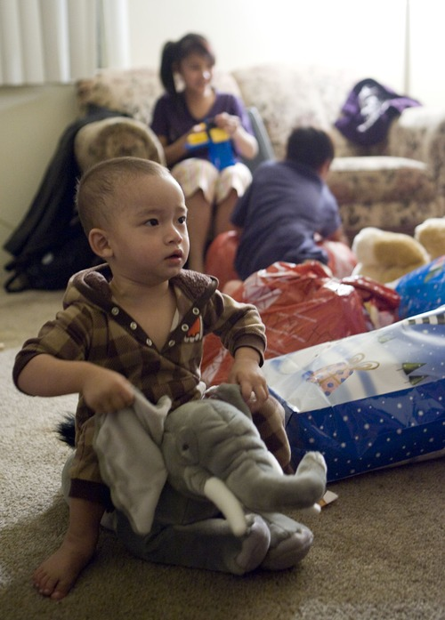 Keith Johnson  | The Salt Lake Tribune Thyu Htoo plays with a stuffed elephant after he and his family of Burmese refugees received gifts delivered by representatives from Catholic Community Services at their home in South Salt Lake, December 12, 2012. The family arrived in Utah only a month ago.