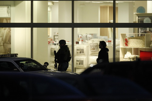 FILE - In this Tuesday, Dec. 11, 2012 file photo, law enforcement personnel work at the scene of a shooting at the Clackamas Town Center mall in Clackamas, Ore. A gunman killed two people and wounded a third amid a holiday crowd estimated at 10,000 people. (AP Photo/The Oregonian, Bruce Ely)  MAGS OUT; TV OUT; LOCAL TV OUT; LOCAL INTERNET OUT; THE MERCURY OUT; WILLAMETTE WEEK OUT; PAMPLIN MEDIA GROUP OUT