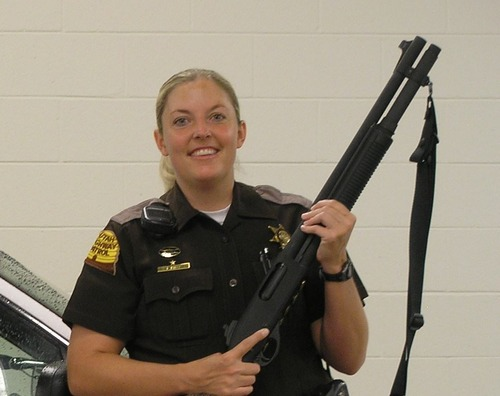 In this photo from the Utah Highway Patrol's 75th anniversary yearbook, Cpl. Lisa Steed stands with a shotgun.  Courtesy Utah Highway Patrol