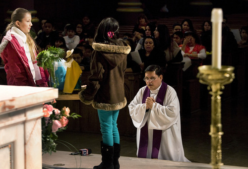 Scott Sommerdorf  |  The Salt Lake Tribune               Father Eleazar Silva leads a service before the Las Posadas procession leaving the Cathedral of the Madeleine on its way through downtown Salt Lake City. This procession honors the Latin American tradition of Las Posadas, Sunday, December 16, 2012.