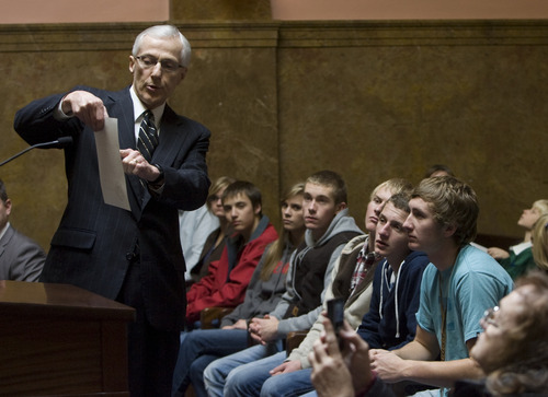 Kim Raff  |  The Salt Lake Tribune Lt. Gov. Greg Bell shows an electoral ballot for the president of the United States to students from Richfield High School who came to observe Utah's electors cast their official Electoral College votes on Monday.