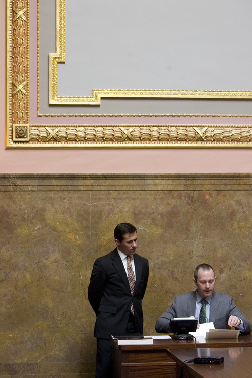 Kim Raff  |  The Salt Lake Tribune (left) Justin Lee, deputy director of elections, listens as Taylor Morgan, election specialist, reads aloud the results of the Electoral College's ballots for vice president of the United States during Utah's vote in the old Supreme Court chambers at the State Capitol in Salt Lake City on Monday, Dec. 17, 2012.