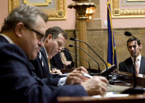 Kim Raff  |  The Salt Lake Tribune (middle) Attorney General-elect John Swallow fills out his Electoral College ballot for vice president of the United States during Utah's vote in the old Supreme Court chambers at the State Capitol in Salt Lake City on Monday, Dec. 17, 2012.