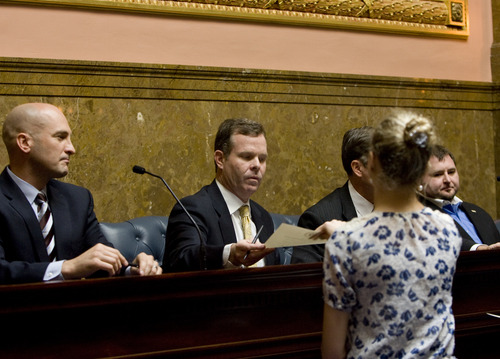 Kim Raff  |  The Salt Lake Tribune (middle) Attorney General-elect John Swallow signs his ballots for president and vice president of the United States during Utah's Electoral College vote in the old Supreme Court chambers at the State Capitol in Salt Lake City on Monday, Dec. 17, 2012.