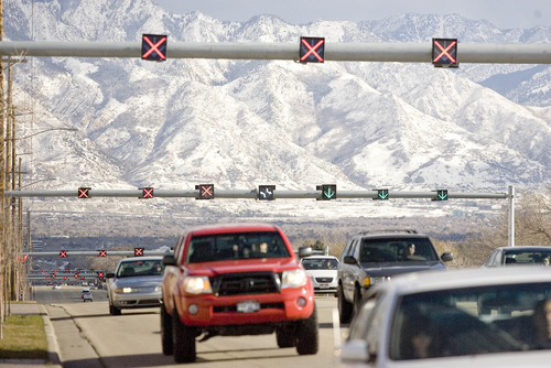 Paul Fraughton  |   The Salt Lake Tribune Traffic lights on the stretch of 5400 South between Bangerter Highway and 1900 West.  Monday, December 17, 2012