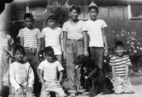 (Photo Courtesy Utah State Historical Society)  Children and their dog at Topaz, Utah.