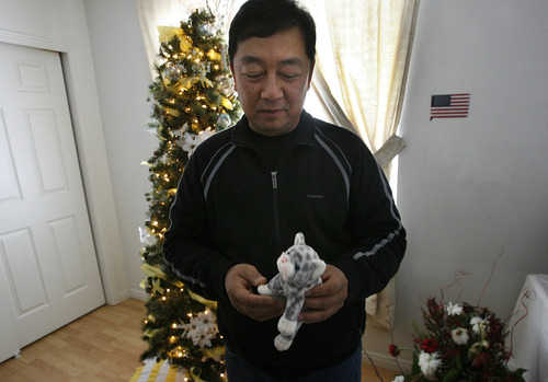 Scott Sommerdorf  |  The Salt Lake Tribune               Nhuan Phan, David Phan's father holds a small stuffed animal from David's youth as he describes some of the things now on display in David's room in their Taylorsville home.  David, 14, committed suicide on Nov. 29 at Bennion Junior High.