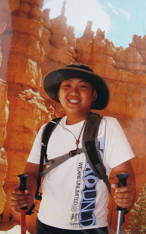 Scott Sommerdorf  |  The Salt Lake Tribune               A family snapshot of David Phan on a hike in Southern Utah. David, 14, loved the outdoorsand hoped to join the military, according to his family. The teen, who was gay, committed suicide on Nov. 29 at Bennion Junior High.