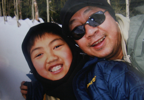 Scott Sommerdorf     The Salt Lake Tribune               A family snapshot of David Phan with his father Nhuan. The Phan family spoke out for first time, Saturday, December 15, 2012 about why David committed suicide on Nov. 29 at Bennion Junior High.