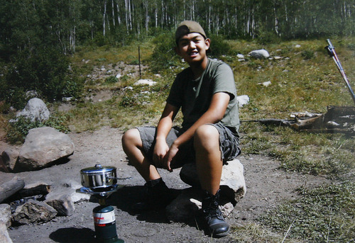 Scott Sommerdorf  |  The Salt Lake Tribune               A family snapshot of David Phan on a camping trip. According to the Phan family, 14-year-old David was gay and felt bullied at school. He committed suicide on Nov. 29 at Bennion Junior High.