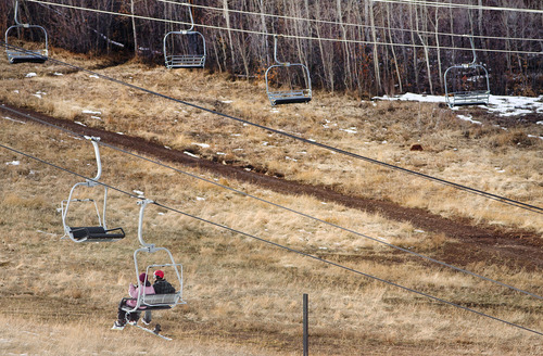 Steve Griffin | The Salt Lake Tribune  Skiers ride the lower lift at Park City Mountain Resort on Thursday, Dec. 6, 2012. A new report warns that global warming will make low-snow years more prevalent and batter the ski industry.