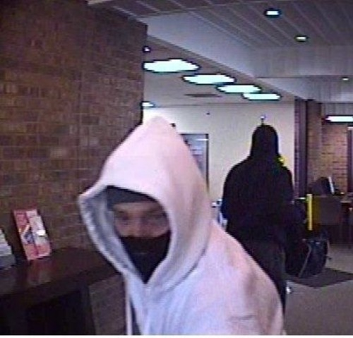 Courtesy image Police are looking for two men who robbed Zions Bank in Salt Lake City on Monday morning. Police say the suspects were two men with hooded sweatshirts and ski masks over their faces. One man was approximately 6 feet tall with a dark-colored hooded sweatshirt. The other man was about 5 feet 8 inches tall with a white hooded sweatshirt.