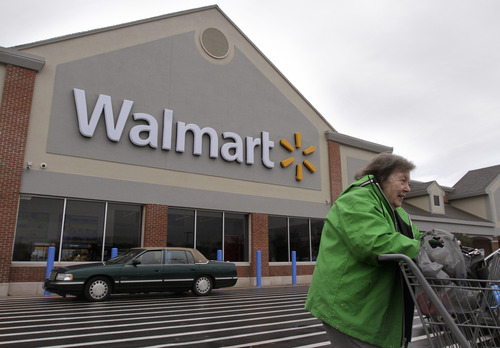 "(AP Photo/Steven Senne) Walmart, the nation's largest retailer, said it removed the information page on the Bushmaster semiautommatic rifle ""in light of the tragic events."" However, it said it had made no changes to its sales policies on guns and ammunition."