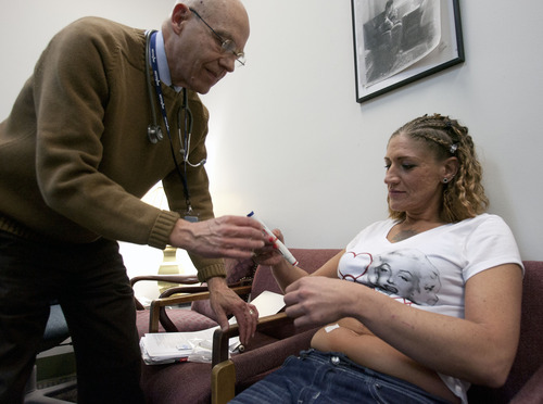 Steve Griffin   The Salt Lake Tribune  Dr. Hal Cole helps Jamie Barnard with her first shot of interferon at the Fourth Street Clinic in Salt Lake City in December.  With the help of the doctors and staff at the clinic Barnard has started a 24 week treatment program that could cure her from the hepatitis c she contracted from intravenous drug use at the age of 19.