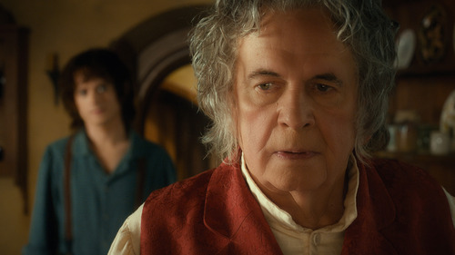 """(L-r) Elijah Wood as Frodo and Ian Holm as Bilbo Baggins in the fantasy adventure  """"The Hobbit: An Unexpected Journey."""" ed by Warner Bros. Pictures and MGM."""
