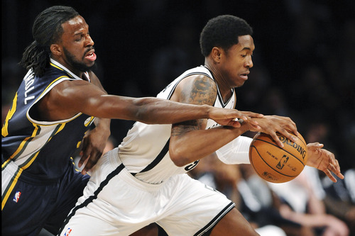 Utah Jazz's DeMarre Carroll (3) pressures Brooklyn Nets' MarShon Brooks (9) in the first half of an NBA basketball game,n Tuesday, Dec., 18, 2012, at Barclays Center in New York. The Jazz won 92-90. (AP Photo/Kathy Kmonicek)