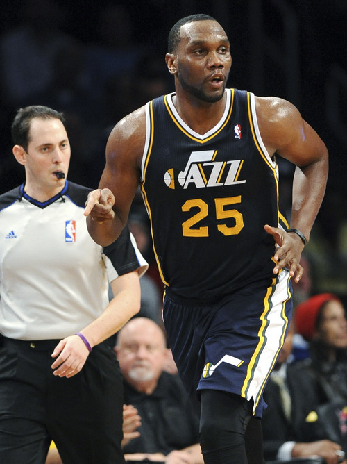 Utah Jazz's Al Jefferson (25) celebrates after scoring against the Brooklyn Nets in the second half of an NBA basketball game, Tuesday, Dec. 18, 2012, at Barclays Center in New York. The Jazz won 92-90. (AP Photo/Kathy Kmonicek)