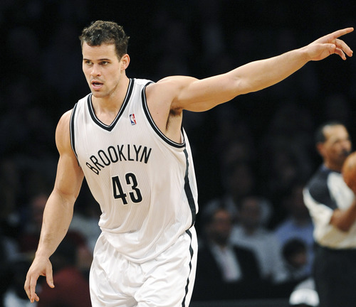 Brooklyn Nets' Kris Humphries celebrates a score against the Utah Jazz in the final seconds of the first half of an NBA basketball game, Tuesday, Dec. 18, 2012, at Barclays Center in New York. (AP Photo/Kathy Kmonicek)