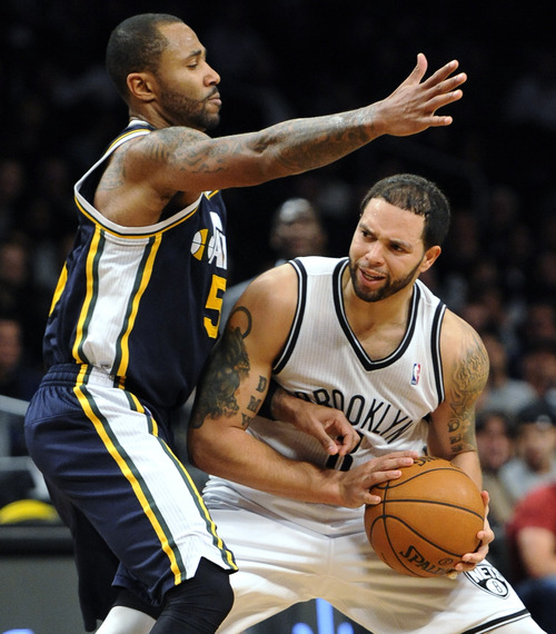 Utah Jazz's Mo Williams (5) guards Brooklyn Nets' Deron Williams (8) in the second half of an NBA basketball game, Tuesday, Dec. 18, 2012, at Barclays Center in New York. The Jazz won 92-90. (AP Photo/Kathy Kmonicek)
