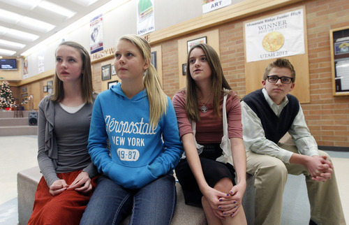 Al Hartmann  |  The Salt Lake Tribune Kaitlin Taylor, left, Emma Young, Alissa George and Max Janda, ninth-grade students at Mountain Ridge Jr. High School in Highland, dressed in school colors of Sandy Hook Elementary School and church clothes to remember and respect those who died in Connecticut.
