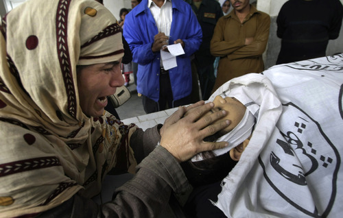 Rukhsana Bibi grieves as she touches the body of her daughter, polio worker Madiha Bibi, killed by unknown gunmen, at a morgue of local hospital in Karachi, Pakistan, Tuesday, Dec. 18, 2012. Gunmen killed several people working on a government polio vaccination campaign in two different Pakistani cities on Tuesday, officials said. The attacks were likely an attempt by the Taliban to counter an initiative the militant group has long opposed. (AP Photo/Fareed Khan)