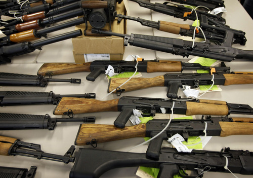 This Tuesday, Jan. 25, 2011 picture shows part of a cache of seized weapons displayed at a news conference in Phoenix. (AP Photo/Matt York)