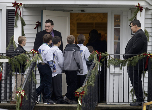 Mourners arrive at the funeral service for 6-year-old Jack Pinto, Monday, Dec. 17, 2012 in Newtown, Conn. Pinto was killed when a gunman walked into Sandy Hook Elementary School in Newtown Friday and opened fire, killing 26 people, including 20 children. (AP Photo/David Goldman)
