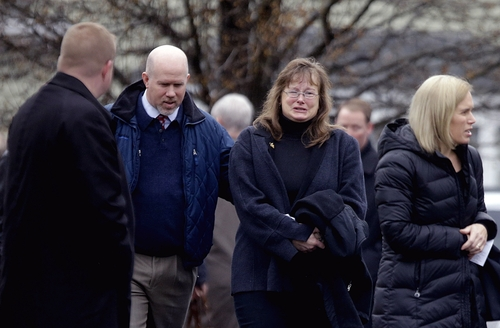 Mourners leave a funeral service of Sandy Hook Elementary School shooting victim, Jack Pinto, 6, Monday, Dec. 17, 2012, in Newtown, Conn. A gunman walked into Sandy Hook Elementary School in Newtown Friday and opened fire, killing 26 people, including 20 children. (AP Photo/David Goldman)