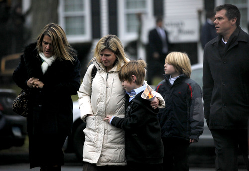 Mourners leave the funeral service of Sandy Hook Elementary School shooting victim, Jack Pinto, 6, Monday, Dec. 17, 2012, in Newtown, Conn. Pinto was killed when a gunman walked into Sandy Hook Elementary School in Newtown Friday and opened fire, killing 26 people, including 20 children.(AP Photo/David Goldman)