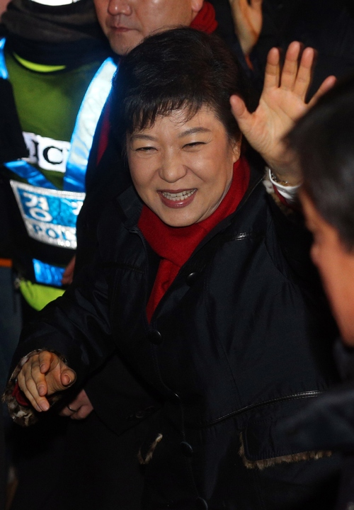 South Korea's presidential candidate Park Geun-hye of the ruling Saenuri Party waves to supporters as she heads to her office from her house in Seoul, South Korea, Wednesday, Dec. 19, 2012. (AP Photo/Yonhap) KOREA OUT