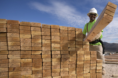 In this  Friday, Nov. 16, 2012, photo, construction worker Miguel Fonseca carries lumber as he works on a house frame for a new home, in Chula Vista, Calif. U.S. builders broke ground on fewer homes in November after starting work in October at the fastest pace in four years. Superstorm Sandy likely slowed starts in the Northeast. The Commerce Department said Wednesday, Dec. 19, 2012, that builders began construction of houses and apartments at a seasonally adjusted annual rate of 861,000. That was 3 percent less than October's annual rate of 888,000, the fastest since July 2008. (AP Photo/Gregory Bull)