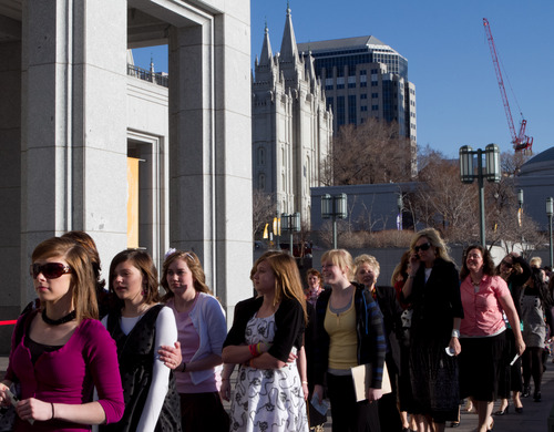 Thomas Nelson  |  The Salt Lake Tribune Skirts and dresses are the clothing of choice for young Mormon women attending a Young Women's Meeting at the LDS Conference Center in downtown Salt Lake City.