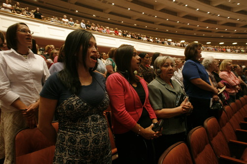 Rick Egan  |  Tribune file photo Faithful LDS women, wearing skirts and dresses, sing with the choir during the General Relief Society meeting at the Conference Center in Salt Lake City in 2009.