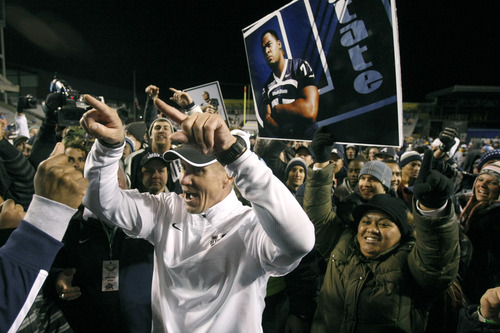 Chris Detrick  |  The Salt Lake Tribune Utah State Aggies head coach Gary Andersen celebrates with the fans after winning the Famous Idaho Potato Bowl at Bronco Stadium Saturday December 15, 2012.  The Aggies beat the Rockets, 41-15.