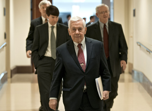 Sen. Richard Lugar, R-Ind., the ranking member of the Senate Foreign Relations Committee, leaves a closed-door briefing on the investigation of the deadly Sept. 11 attack on the U.S. consulate in Benghazi, Libya, at the Capitol in Washington, Wednesday, Dec. 19, 2012.  An Accountability Review Board's report indicates serious bureaucratic mismanagement was responsible for the inadequate security at the mission in Benghazi where the U.S. ambassador and three other Americans were killed. (AP Photo/J. Scott Applewhite)