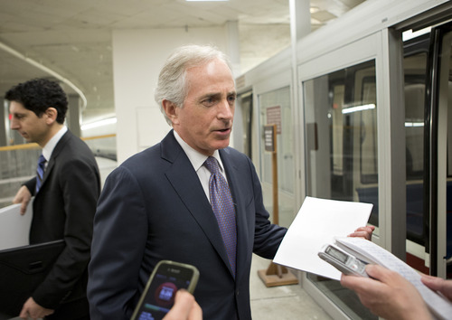 Sen. Bob Corker, R-Tenn., a member of the Senate Foreign Relations Committee, speaks to reporters following a closed-door briefing on the investigation of the deadly Sept. 11 attack on the U.S. consulate in Benghazi, Libya, at the Capitol in Washington, Wednesday, Dec. 19, 2012. An Accountability Review Board's report indicates serious bureaucratic mismanagement was responsible for the inadequate security at the mission in Benghazi where the U.S. ambassador and three other Americans were killed. (AP Photo/J. Scott Applewhite)