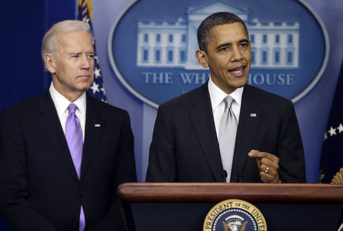 President Barack Obama stands with Vice President Joe Biden as he makes a statement Wednesday, Dec. 19, 2012, in the Brady Press Briefing Room at the White House in Washington, about policies he will pursue following the massacre at Sandy Hook Elementary School in Newtown, Ct. Obama is tasking Biden, a longtime gun control advocate, with spearheading the effort. (AP Photo/Charles Dharapak)