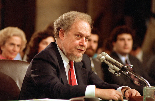 FILE - In this Sept. 16, 1987 file photo, U.S. Supreme Court nominee Robert H. Bork testifies before the Senate Judiciary Committee during his confirmation hearings on Capitol Hill.   Robert Bork, whose failed Supreme Court nomination made history, has died.  (AP Photo/Charles Tasnadi)