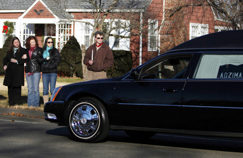 A hearse bearing the body of Victoria Soto drives past a group of onlookers as it arrives for her funeral service at Lordship Community Church, Wednesday, Dec. 19, 2012, in Stratford, Conn.  Soto was killed when a gunman forced his way into Sandy Hook Elementary School in Newtown,  Dec.14,  and opened fire, killing 26 people, including 20 children. (AP Photo/Jason DeCrow)