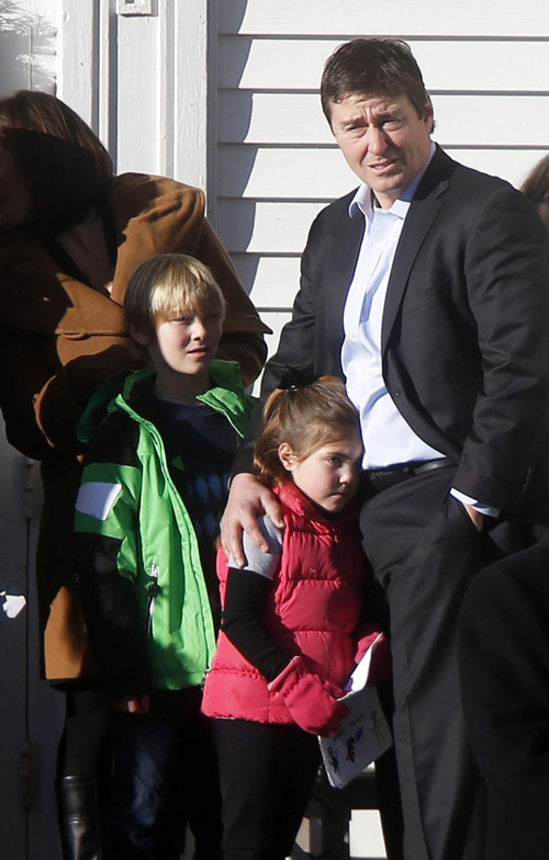 Mourners wait outside before the funeral service of Victoria Soto at Lordship Community Church, Wednesday, Dec. 19, 2012, in Stratford, Conn.  Soto was killed when a gunman forced his way into Sandy Hook Elementary School in Newtown, Dec. 14,  and opened fire, killing 26 people, including 20 children. (AP Photo/Jason DeCrow)