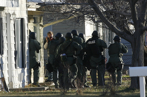 Francisco Kjolseth  |  The Salt Lake Tribune A man involved in a standoff confronts police outside his house on Thursday.
