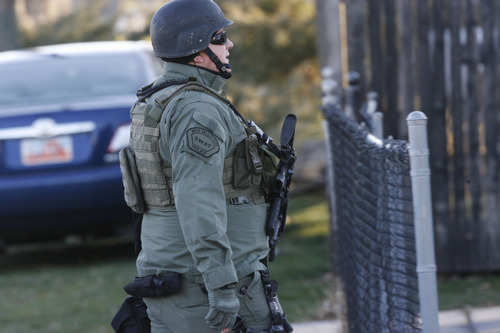 Francisco Kjolseth  |  The Salt Lake Tribune West Valley City police SWAT evacuate a 2-3 block area surrounding 3150 S. Cantwell St. (2910 West), as they deal with a suspect who reportedly fired a gun during a standoff at a home.